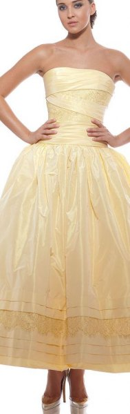 yellow strapless fit and flare shiny maxi prom dress