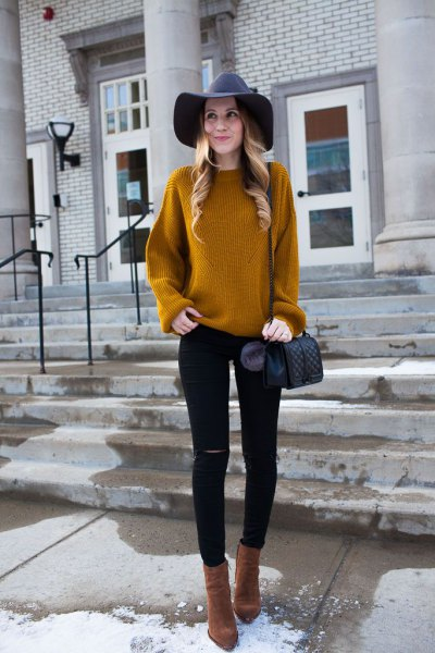 yellowish brown ribbed sweater with black floppy hat