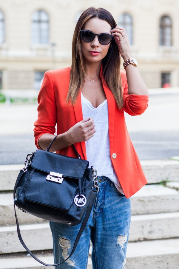 best orange blazer with white deep v neck t shirt and ripped jeans