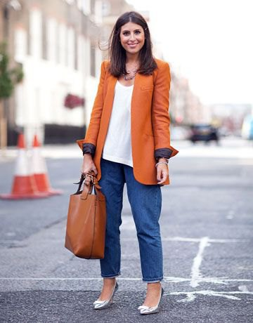 best orange oversized jacket with blue wide leg mom jeans