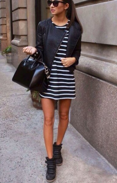 black and white striped mini shift dress with leather jacket