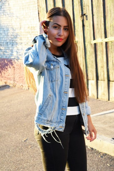 black and white wide striped sweater with denim jacket and pull on jeans