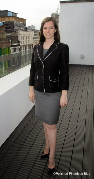black blazer with grey top and matching pencil skirt