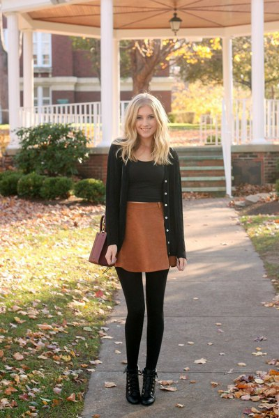 black cardigan with black crop top and brown high rise mini skirt