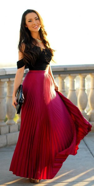 black cold shoulder top with red pleated maxi flowy skirt