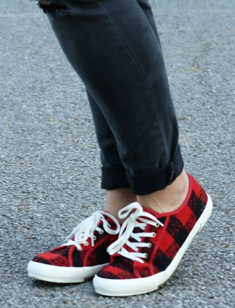 black cuffed jeans with red plaid lace up canvas shoes