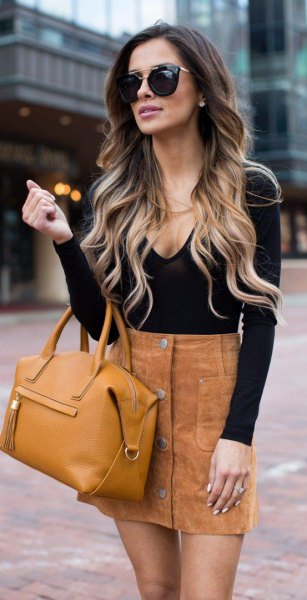 black deep v neck form fitting long sleeve top with mini brown skirt
