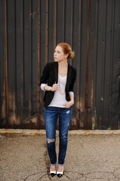 black half sleeve jacket with white scoop neck tank top and blue jeans