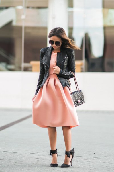 black leather jacket with blush pink fit and flare midi dress