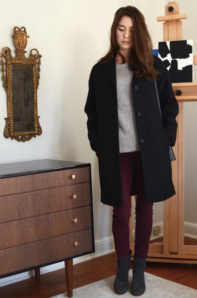 black long coat with grey sweater and dark skinny jeans