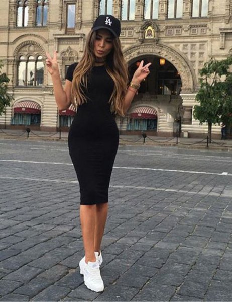 black mini short sleeve dress with baseball cap and sneakers