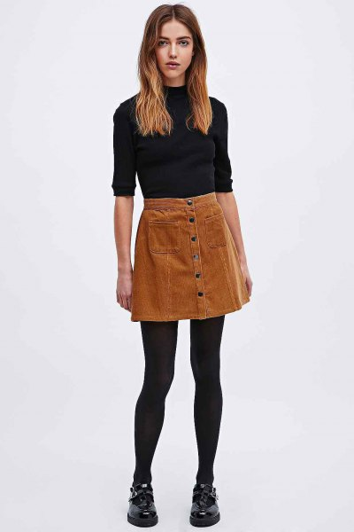 black mock neck half sleeve sweater with brown button up corduroy mini skirt