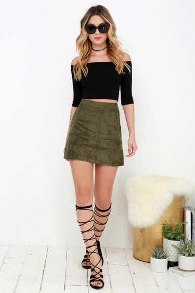 black off the shoulder crop top with olive green mini skirt and gladiator shoes