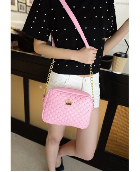 black polka dot tee with white mini denim shorts and blush leather shoulder bag