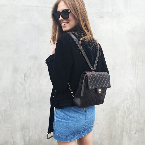black quilted leather backpack purse with velvet jacket and denim mini skirt