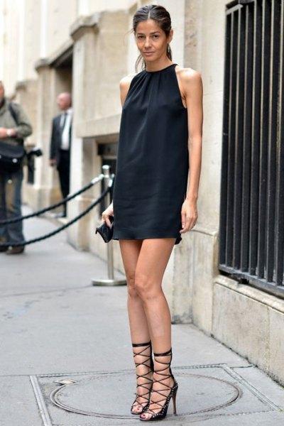 black sleeveless mini shift dress with gladiator heels