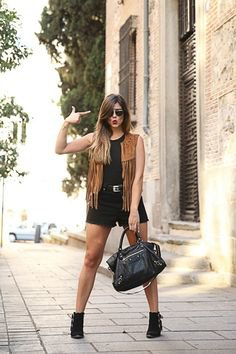 black sleeveless tank top with denim mini shorts
