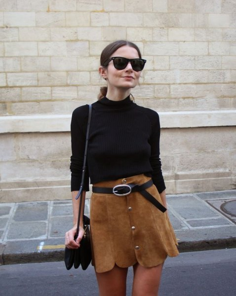 black sweater with brown scalloped hem belted mini skirt