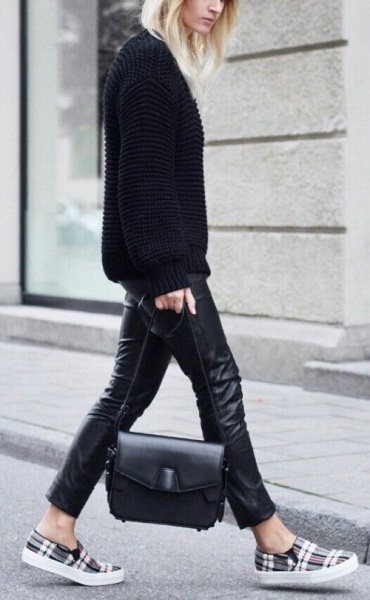 black sweater with leather leggings and grey plaid shoes