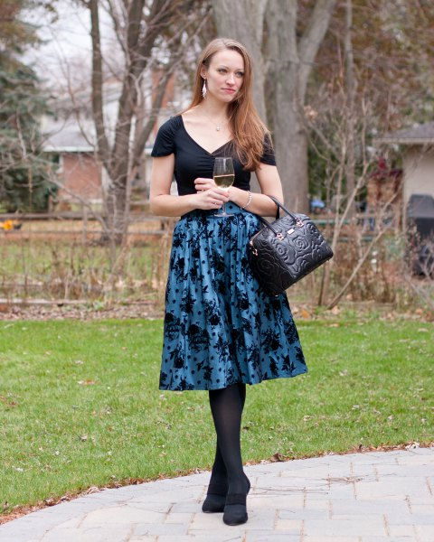 black v neck tee with purple printed midi taffeta flared skirt