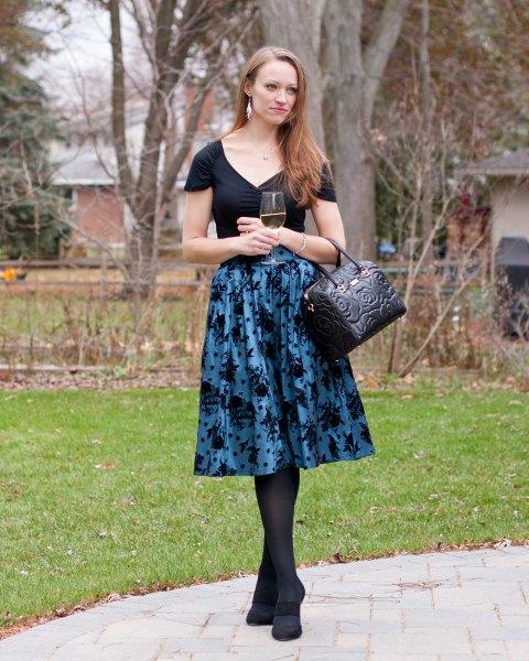 black v neck tee with purple printed midi taffeta flared skirt