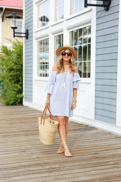 blue and white striped off the shoulder mini shift dress with straw tote bag