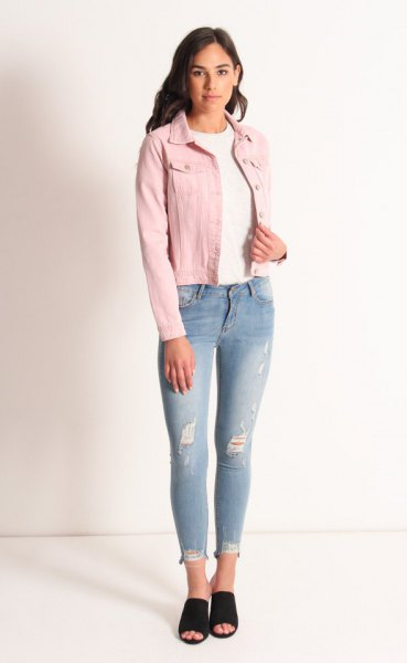 blush denim jacket with white crew neck sweater and light blue jeans