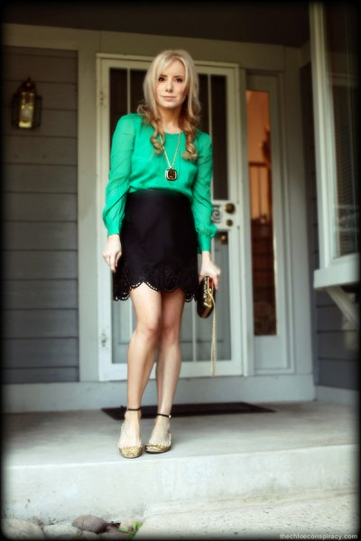 buttonless blouse with black high waisted scalloped hem mini skirt