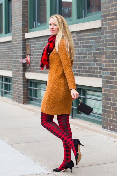 cable knit sweater dress with red and black plaid leggings