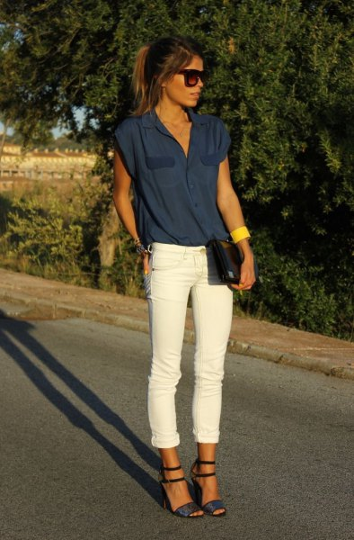 dark navy blue sleeveless blouse with white cuffed jeans