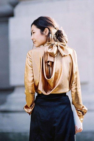 gold cowl neck back metallic blouse with black mini skirt
