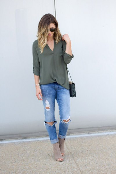 green blouse with ripped boyfriend jeans