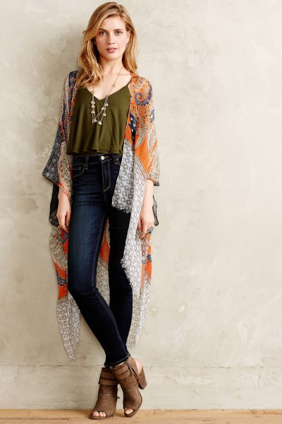 green cropped spaghetti strap top with silk cape and dark jeans