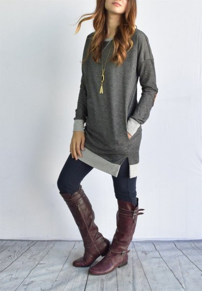 grey color block tunic top with dark skinny jeans and leather knee high boots