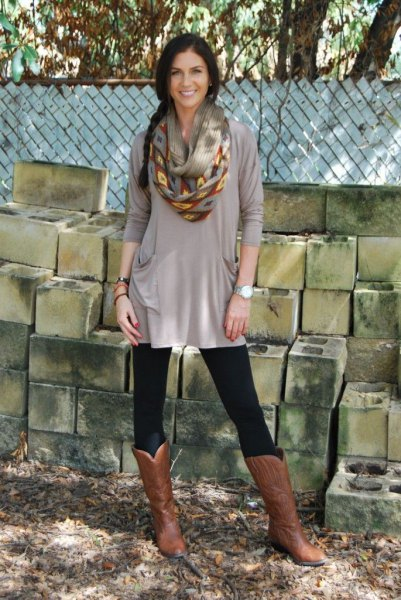 grey dressy tunic top with leggings and brown leather knee high boots