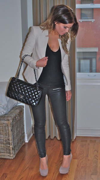 grey jacket with scoop neck tank top and leather pants