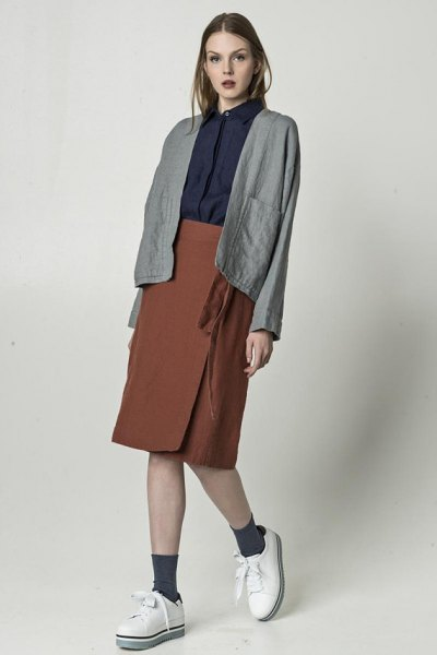 grey linen blazer with black shirt and green knee length wrap skirt