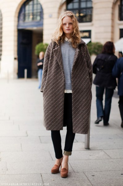 grey longline coat with sweater and black jeans