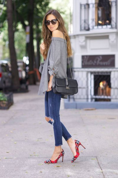 grey off the shoulder blouse with blue ripped ankle jeans and plaid shoes