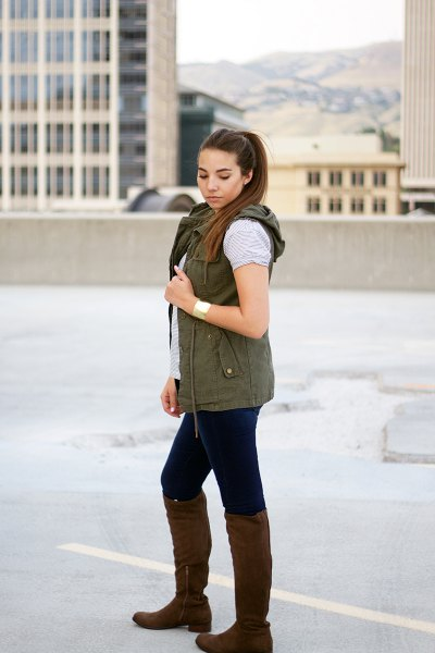 hooded vest with grey t shirt and knee high boots