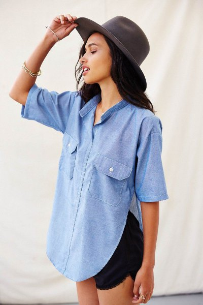 light blue half sleeve chambray side slit button up shirt with black mini shorts