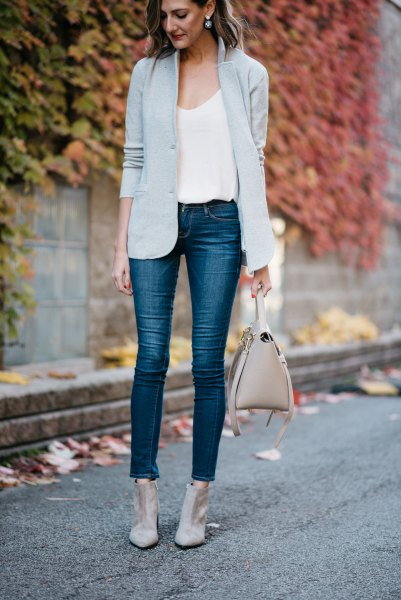 light grey blazer with white scoop neck tank top and cropped jeans