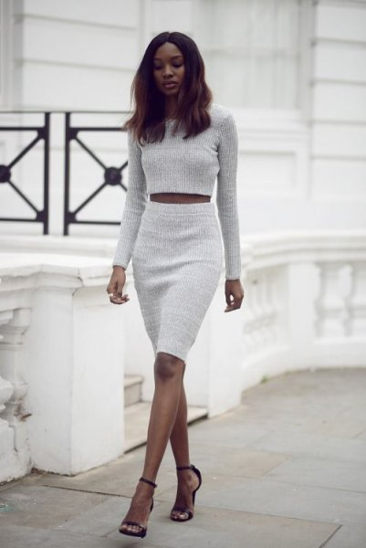 light grey cropped sweater with matching high waisted knee length skirt