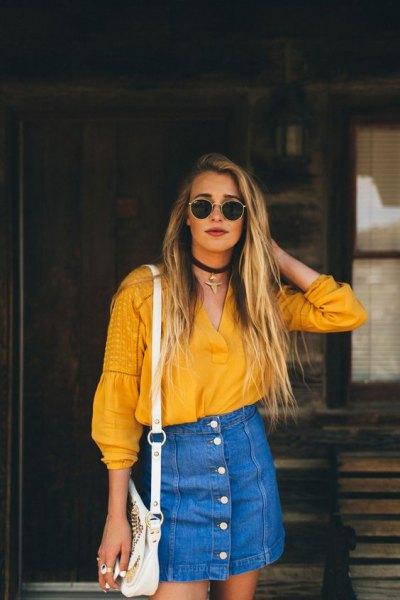 mustard v neck blouse with blue denim high waisted mini skirt