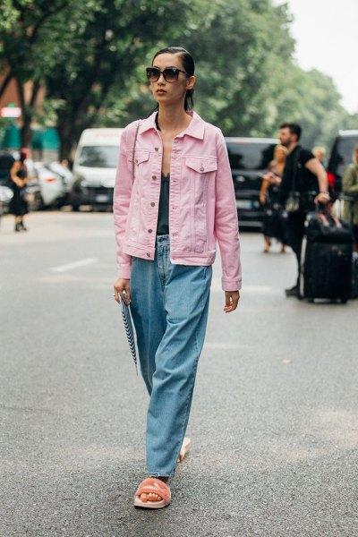 pale pink denim jacket with black deep v neck tank top and wide leg jeans