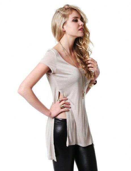 pale pink side slit shirt with black leather leggings