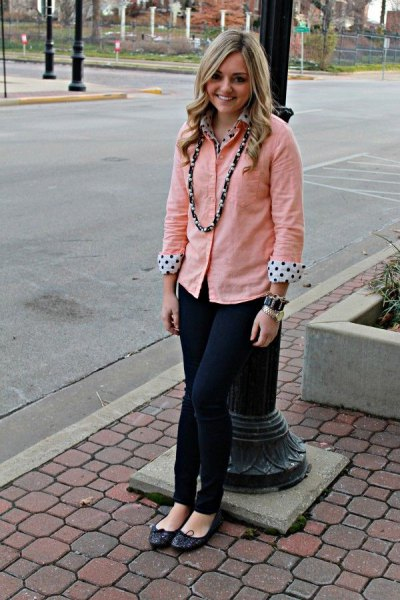 peach button up shirt over white and black polka dot blouse