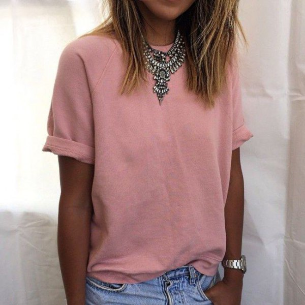 peach cuffed t shirt with tribal style statement necklace and jeans