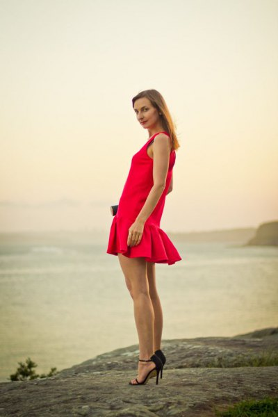 red fishtail mini sleeveless dress with black heels