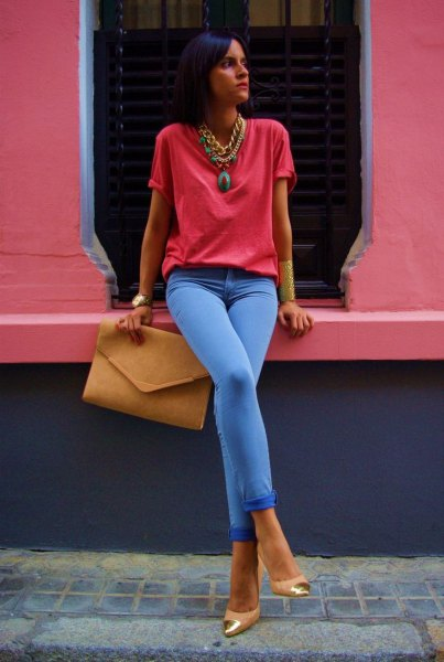 red t shirt with sky blue jeans and statement necklace